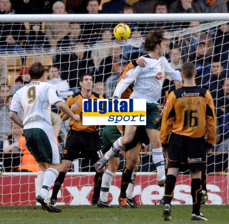 Photo: Glyn Thomas.<br />Wolverhampton Wanderers v Plymouth Argyle. Coca Cola Championship. 31/12/2005.<br />Plymouth's Elliott Ward (second from R) heads his team into a 1-0 lead against the run of play.