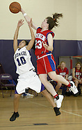 Goshen's Kathleen Payne blocks a shot by Monroe-Woodbury's Carmen Miran during a game in Central Valley on Jan. 25, 2008. Payne was called for a foul on the play.