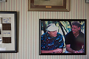 A photo of Dale Hansen and Troy Aikman hangs on the wall at his home in Waxahachie, Texas on September 30, 2017. (Cooper Neill for The New York Times)