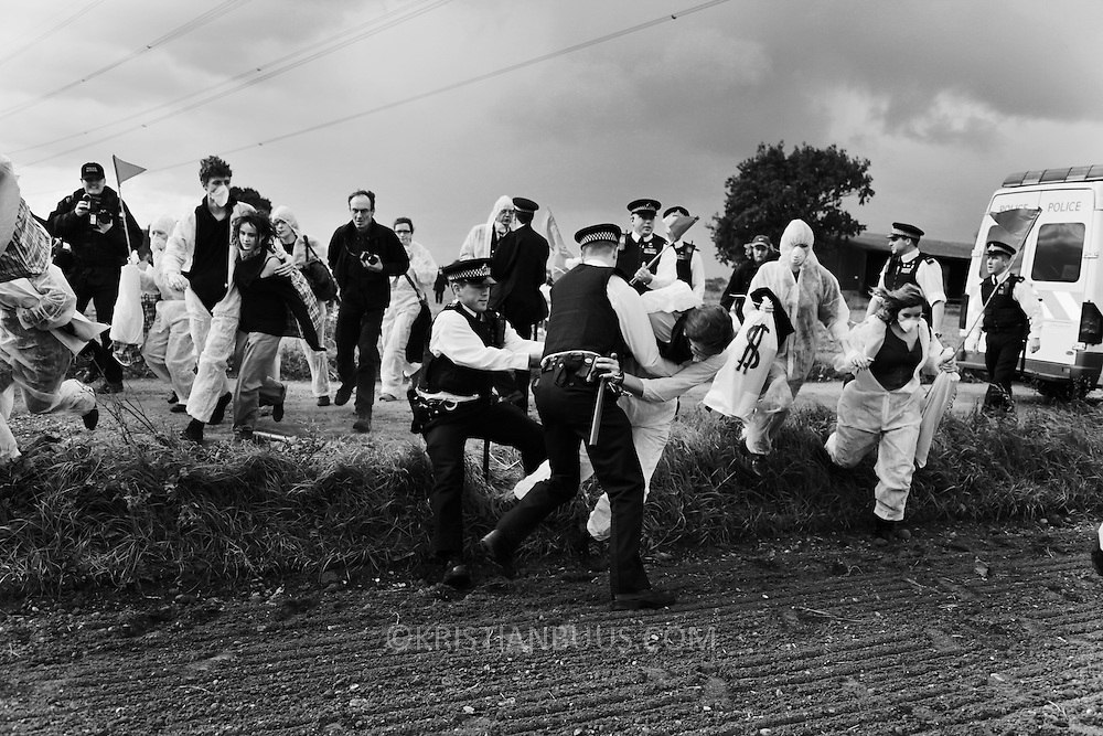 Climate activists from the Building Block, one of three grops of activists, are making their way across fields and passed police to join the ongoing blockade of Coryton oil refinery. The out numbered police manage to stop a few activists and confiscate some materials but fail to make any arrests. The activists are all peaceful and avoid arrest only by peaceful means, by out-running police and out number them...Crude Oil Awakening is a coalition of climate change activist groups. On Saturday Oct 16 they shut the only entrance to Coryton oil refinery in Essex, UK with the aim of highlighting the issues of climate change and the burning of fossil fuels. The blockade meant that a great number of trucks with oil were not able to leave the refinary during the day of action.