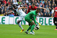 Swansea city's Nathan Dyer is denied by Man Utd keeper David de Gea and Nemanja Vidic.. Barclays Premier league, Swansea city v Manchester Utd in Swansea, South Wales on Saturday 17th August 2013. pic by Andrew Orchard ,Andrew Orchard sports photography,