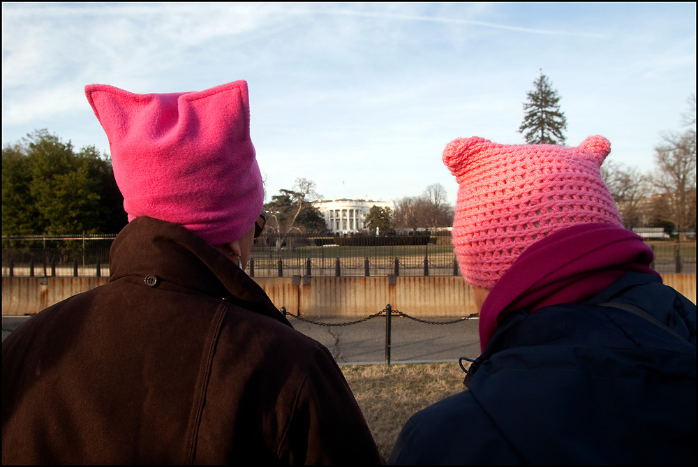 """Women's March attendees visited the White house on the eve of the inauguration of Donald J. Trump.<br /> <br /> A pussyhat is a pink, crafted hat, created in large numbers by thousands of participants involved with the United States 2017 Women's March. They are the result of the Pussyhat Project, a nationwide effort initiated by Krista Suh and Jayna Zweiman, to create pink hats to be worn at the march for visual impact.<br /> <br /> The creators state that the name refers to the resemblance of the top corners of the hats to cat ears while also attempting to reclaim the term """"pussy"""", a play on Trump's widely reported 2005 remarks that women would let him """"grab them by the pussy."""""""