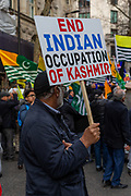 "A placard reads ""End Indian Occupation of Kashmir"" meanwhile hundreds of British Kashmiri protestors assembled outside the Indian High Commission on Sunday, 26 January 2020 to protest against Indian occupation of Kashmir and the lockdown of the occupied territory following the revocation of Article 370.<br /> The north-eastern region, on the border with Pakistan, is the only Muslim majority state in Hindu-dominated India. But in August 2019, the Indian government revoked Kashmir's special status – this had previously allowed it to have its own constitution and internal government."