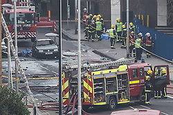 © licensed to London News Pictures. London, UK 16/01/2013. Fire brigades and emergency services attending to a helicopter crash in Vauxhall, London. Photo credit: Tolga Akmen/LNP