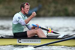 Cambridge Men's Blue Boat's Luke Juckett celebrates victory in the Men's Boat Race on the River Thames, London.