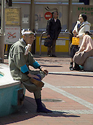 an elderly man in traditional construction worker clothing Tokyo