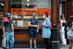 © Licensed to London News Pictures. 12/06/2021. LONDON, UK. Customers outside Sounds of the Universe Records in Soho on Record Store Day, where independent record shops worldwide celebrate music, including special vinyl releases made exclusively for the day. In the UK, vinyl sales have increased for the 13th consecutive year.  The BPI reported that nearly 5m records were sold in the 2020 in the UK as, with more time spent at home, music lovers had time to add to their collections.  Photo credit: Stephen Chung/LNP