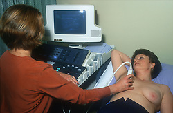 Technician giving woman an ultrasound examination,