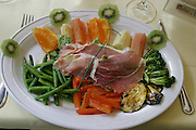 Serrano ham, grilled vegetables, and fruit for lunch in a bistro in Paris, France. (From a photographic gallery of meals in Hungry Planet: What the World Eats, p. 244).