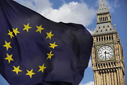 File photo dated 02/07/16 of a European Union flag in front of Big Ben, as Finance chiefs have warned that Brexit uncertainty is impacting business decisions and expect conditions to deteriorate further once the UK leaves the EU.