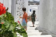 Greece, Amorgos, Cyclades: children run through the streets of Amorgos