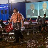 NYTDEBATE20  LITITZ, PA:  Supporters wear ponchos and depart in the ran during the first Presidential debate between President Donald Trump and former Vice President Joe Biden at a Make America Great Again! Presidential debate watch party at Meadow Spring Farm in Lititz, PA on September 29, 2020.  CREDIT:  Mark Makela for The New York Times