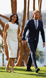 The Duke and Duchess of Sussex walk in the grounds of Admiralty House in Sydney on the first day of the royal couple's visit to Australia.