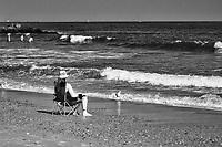 Relaxing on the Rockaway beach in Queens, New York City.