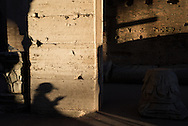The shadow of woman on her cell phone inside the Colosseum in Rome, Italy