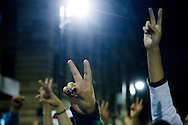 People making the victory V sign in a demonstration in Mexico City in favor of the 43 missing students in Guerrero state