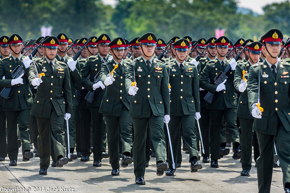 29 SEPTEMBER 2014 - NAKHON NAYOK, NAKHON NAYOK, THAILAND: Thai soldiers march on the parade ground at Chulalomklao Royal Military Academy during the retirement ceremony for more than 200 Thai generals including Gen. Prayuth Chan-ocha, who led the 22 May coup against the civilian government earlier this year. Prayuth has been chief of the Thai army since 2010. After his retirement, Gen. Prayuth will retain his posts as head of the junta's National Council for Peace and Order (NCPO) and Prime Minister of Thailand. Under Thai law, military officers must retire at 60 years of age. The 200 generals who retired with Prayuth were also his classmates at the Chulalomklao Royal Military Academy in Nakhon Nayok.    PHOTO BY JACK KURTZ