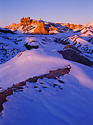 Snow-covered badlands of the Chinle Formation, Blue Mesa, Petrified Forest National Park, Arizona.