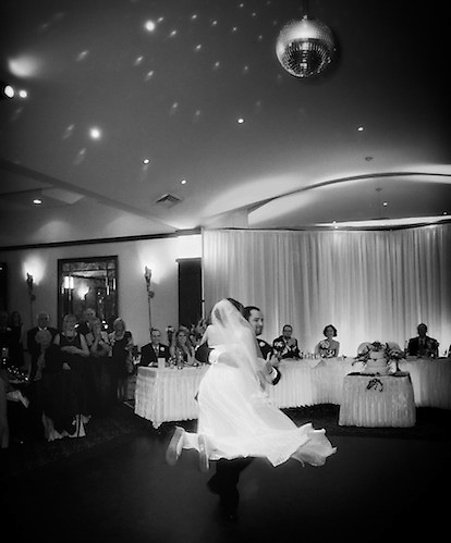 The groom lifts his new bride into the air during their first dance. To view the newlywed's complete Wedding Gallery Collection, please visit the Client Area and log-in. You'll be able to view these and other images as a slideshow, order prints and more.