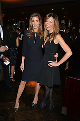 Left to right, CINDY CRAWFORD and HEATHER KERZNER at the OMEGA VIP dinner hosted by Cindy Crawford and OMEGA President Mr. Stephen Urquhart held at aqua shard', Level 31, The Shard, 31 St Thomas Street, London, SE1 9RY on 10th December 2014.