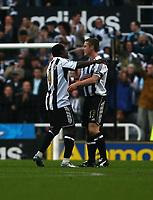 Photo: Andrew Unwin.<br />Newcastle United v Tottenham Hotspur. The Barclays Premiership. 23/12/2006.<br />Newcastle's Obafemi Martins (L) celebrates his goal with Scott Parker (R).