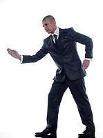 caucasian man businessman walking  portrait isolated studio on white background