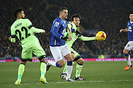 Kevin Mirallas of Everton and David Silva of Manchester City battle for the ball. Capital one cup semi final 1st leg match, Everton v Manchester city at Goodison Park in Liverpool on Wednesday 6th January 2016.<br /> pic by Chris Stading, Andrew Orchard sports photography.