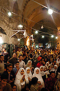 Muslim children and adults participate in a Ramadan celebration hosted by the Old City Youth Association in Jerusalem Thursday evening, November 6, 2003. ..Photo by Erin Lubin