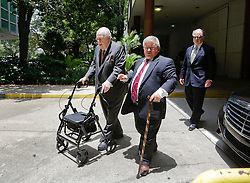 11 June  2015. New Orleans, Louisiana. <br /> Tom Benson arrives at Civil District Court assisted by his driver and a walker frame. Benson, the billionaire owner of the NFL New Orleans Saints, the NBA New Orleans Pelicans, various auto dealerships, banks, property assets and a slew of business interests is attending a hearing to determine his level of competency to manage his business empire. Benson changed his succession plans and  decided to leave the bulk of his estate to third wife Gayle, sparking a controversial fight over control of the Benson business empire.<br /> Photo©; Charlie Varley/varleypix.com
