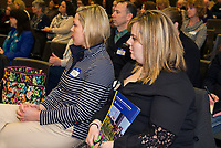 Audience members listen to the panel of community leaders during the Lakes Region Workforce Development Resource Summit on Friday morning.  (Karen Bobotas/for the Laconia Daily Sun)