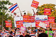 """Apr. 2, 2010 - BANGKOK, THAILAND: Thousands of """"Pink Shirts"""" gathered in Lumpini Park in central Bangkok Friday evening to call for """"peace in the land,"""" a play on the Red Shirts slogan, """"Red in the Land."""" The """"Pink Shirts"""" represented educators, business people and people in the tourist industry, all of which have been hurt by the ongoing political protests that have disrupted life in the Thai capital. The """"Pink Shirts"""" stressed their loyalty to His Majesty Bhumibol Adulyadej, the King of Thailand, and chanted for the Red Shirts to """"Get Out!"""" of Bangkok.    PHOTO BY JACK KURTZ"""