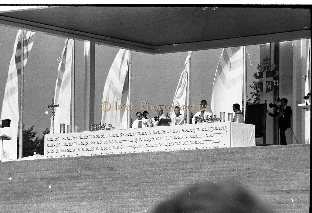 Pope John-Paul II visits Ireland..1979..29.09.1979..09.29.1979..29th September 1979..Today marked the historic arrival of Pope John-Paul II to Ireland. He is here on a three day visit to the country with a packed itinerary. He will celebrate mass today at a specially built altar in the Phoenix Park in Dublin. From Dublin he will travel to Drogheda by cavalcade. On the 30th he will host a youth rally in Galway and on the 1st Oct he will host a mass in Limerick prior to his departure from Shannon Airport to the U.S..Image of Pope John-Paul II celebrating mass on the altar in The Phoenix Park.
