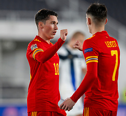HELSINKI, FINLAND - Thursday, September 3, 2020: Wales' Harry Wilson (L) and Dylan Levitt celebrate at the final whistle during the UEFA Nations League Group Stage League B Group 4 match between Finland and Wales at the Helsingin Olympiastadion. Wales won 1-0. (Pic by Jussi Eskola/Propaganda)