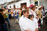 The town's market vendors, their friends and extended family parade through Paracho, Michoacan state, Mexico on August 8, 2008 during the annual Feria Internacional de la Guitarra. Parades for different professions are held each day of the week-long festival, culminating in the parade of the guitar makers.