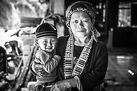 Red Dzao woman with her cute & smiley grandson.