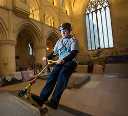 "© Licensed to London News Pictures 15/02/2017, Malmesbury, UK. The ""Malmesbury Abbey Skate"" now in its's 9th year, where the interior of the 12th century abbey in Malmesbury, Wiltshire is turned into a skate park for 3 days during the February half term. Pictured here: 15 year old George Mcgrory on his scooter.<br /> Photo Credit : Stephen Shepherd/LNP"