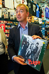 © Licensed to London News Pictures. 29/07/2015. Surrey, UK. Newly elected Liberal Democrat leader Tim Farron looking at a The Clash record whilst visiting Banquet Records in Kingston upon Thames on Wednesday, July 29, 2015. Photo credit: Tolga Akmen/LNP