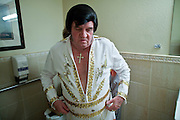 Aug. 2 - PHOENIX, AZ: DONALD TRAPANI dresses as Elvis Presley in a restroom at The Stratford, an Alzheimer's care facility in Phoenix, AZ. Trapani, 68, was diagnosed with lung cancer in August 2009 and entered the care of Hospice of the Valley, the largest hospice organization in Phoenix, shortly after that. His doctor said he would be dead by the end of February 2010. Trapani is in still in the care of Hospice of the Valley, but his condition has improved. He now entertains other hospice patients singing the songs of Elvis Presley. He tries to hold one concert each week, his health permitting, at different hospice units in the Phoenix area.     Photo by Jack Kurtz