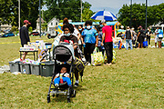 """19 JULY 2020 - DES MOINES, IOWA: People look at what's available during """"A Celebration of Black Motherhood"""" in Des Moines Sunday. The event was organized by the Supply Hive and Black Lives Matter. Items were donated by members of the community and redistributed to at risk families. They distributed diapers, sanitary products, clothes, books, and toys. They had enough material to help 200 families.         PHOTO BY JACK KURTZ"""