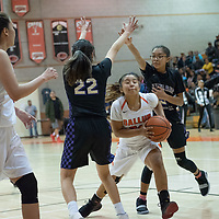 On Tuesday night, Kamryn Yazzie (20) of Gallup makes a move between two Kirtland Central defenders for the score  in Gallup. Kirtland Central won 62-53.