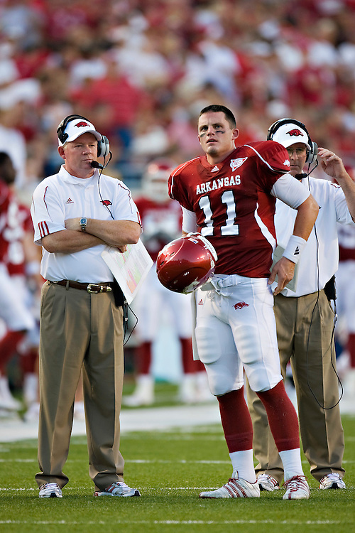 LITTLE ROCK, AR - SEPTEMBER 6:   Casey Dick #11 and Bobby Petrino of the Arkansas Razorbacks talk during a timeout against the Louisiana-Monroe Warhawks at War Memorial Stadium on September 6, 2008 in Little Rock, Arkansas.  The Razorbacks defeated the Warhawks 28-27.  (Photo by Wesley Hitt/Getty Images) *** Local Caption *** Casey Dick; Bobby Petrino