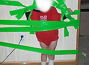 01/10/2010 - USA<br /> First shocking pictures of the toddler taped to a wall by his 'high' mother and her boyfriend<br /> <br /> These are the first heartbreaking photos of a boy being subjected to unbelievable cruelty by his mother and her boyfriend.<br /> The 22-month-old toddler was stuck to a wall in his home by industrial duct tape after his mother had been 'partying' with her lover at her home near Lincoln, Nebraska.<br /> Jayla Hamm,18, even held her helpless son against the wall while boyfriend Corde Honea,19, taped his wrists, legs and body.<br /> Hamm and Honea then took these pictures of the crying child and further taunted him by taping his favourite drinking cup just outside his reach.<br /> <br /> The couple's callous actions were only discovered when Hamm showed the pictures to a friend, who immediately alerted police.<br /> Police then seized the digital camera containing the photos of the boy.<br /> The face of the child has been purposefully obscured in these images but police said he was visibly distressed and crying while pinned to the wall with the adhesive tape.<br /> One picture shows him straining to release himself from his bonds, his arms bent back in an uncomfortable position as his hands are taped to the wall.<br /> Another shows the boy now strapped to the wall with tape across his little body - with one strip of the strong adhesive tape coming into direct contact with the skin on his legs.<br /> Police said the couple, who were 'were high after a night of partying', taped the child to the wall for their entertainment - not to discipline him.<br /> Photo Shows: Disgusting: The boy's arms are restrained behind his back, his hands taped to the wall. His face is obscured in this image but police say he was terrified<br /> ©Exclusivepix