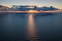 Late summer sun low on horizon over Norwegian sea, Lofoten Islands, Norway