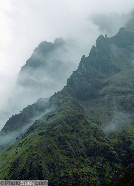 Mist covers a ridge near Punta Union Pass on the Santa Cruz Trek, Huascaran National Park, Cordillera Blanca, Andes Mountains, Peru, South America. UNESCO honored Huascaran National Park on the World Heritage List in 1985. Cordillera Blanca mountain range is in the Sierra Central of the Peruvian Andes.