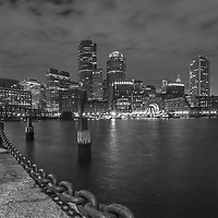 Boston Harbor skyline black and white photography from New England Photography Guild member and award winning fine art photographer Juergen Roth showing Boston Financial Waterfront District landmarks such as One International Place, Boston Harbor Hotel, Independence Wharf, Department of Homeland Security building, and other structures along Rowes Wharf photographed on a beautiful winter sunset evening. The last light was painting the cloudscape in fire red hues and the long exposure time ensured the intentional blurry cloud movement. <br /> <br /> B&W photos of Boston are available as museum quality photo prints, canvas prints, wood prints, acrylic prints or metal prints. Fine art prints may be framed and matted to the individual liking and decorating needs:<br /> <br /> https://juergen-roth.pixels.com/featured/black-and-white-boston-juergen-roth.html<br /> <br /> All digital Boston skyline photography images are available for photo image licensing at www.RothGalleries.com. Please contact me direct with any questions or request.<br /> <br /> Good light and happy photo making!<br /> <br /> My best,<br /> <br /> Juergen<br /> Prints: http://www.rothgalleries.com<br /> Photo Blog: http://whereintheworldisjuergen.blogspot.com<br /> Instagram: https://www.instagram.com/rothgalleries<br /> Twitter: https://twitter.com/naturefineart<br /> Facebook: https://www.facebook.com/naturefineart