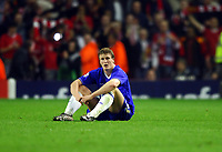 LIVERPOOL V CHELSEA 03/05/2005  (0-0) CHAMPIONS LEAGUE SEMI-FINAL 2ND LEG<br />DEJECTED ROBERT HUTH (CHELSEA) AS LIVERPOOL CELEBRATE VICTORY<br />Photo Roger Parker Fotosports International