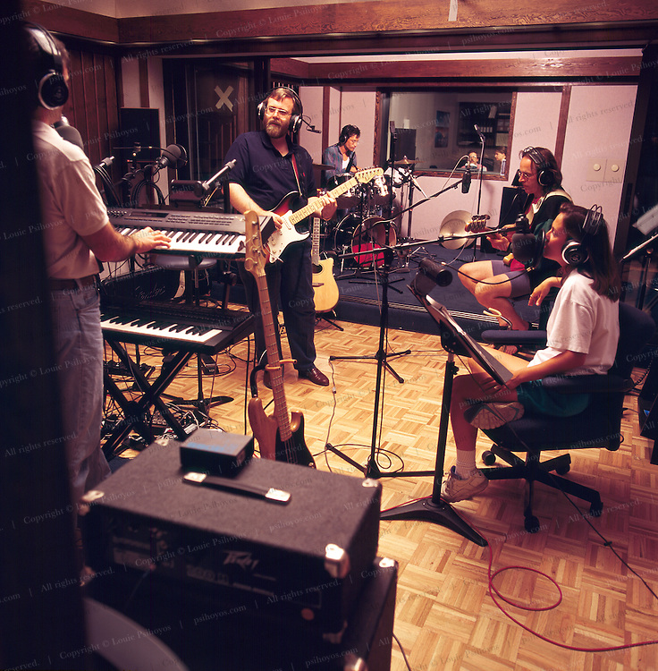 Paul Allen, co-founder of Microsoft, Billionaire and owner of several superyachts and founder of the Rock and Roll Museum in Seattle jams in his private recording studio with his band, the Threads.