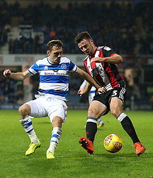 Sheffield United's Enda Stevens and Queens Park Rangers' Josh Scowen battle for the ball during the game during the Sky Bet Championship match at Loftus Road, London.
