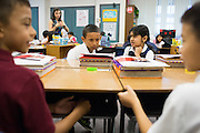 Luis Magana, left, and Jasmeen Bains share summer experiences during a friendship exercise in Laura Polden's third grade class during the first day of school at Zanker Elementary School in Milpitas, California, on August 19, 2013. (Stan Olszewski/SOSKIphoto)