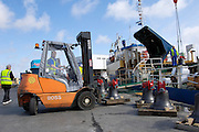 UK, Penzance - Monday, March 23, 2009: A forklift truck moves one of the bells during loading onto the Isles of Scilly Steamship Company's supply vessel the Gry Maritha to be transported to St Mary's. (Image by Peter Horrell / http://www.peterhorrell.com)